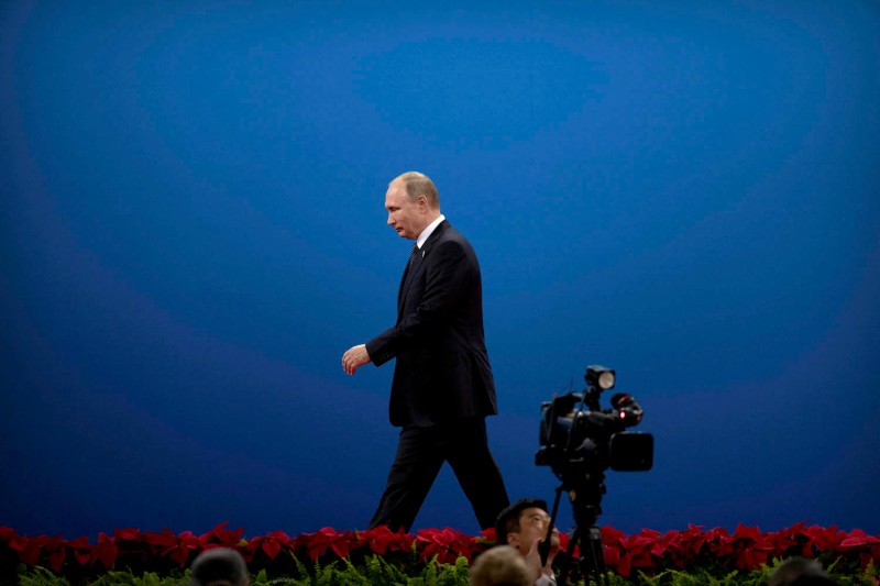 Russian President Vladimir Putin leaves the stage after speaking during the opening ceremony of the Belt and Road Forum at the China National Convention Center in Beijing on May 14, 2017.