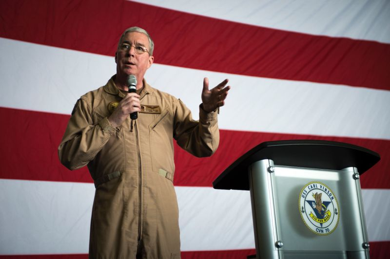 Vice Adm. John Miller, the commander of the U.S. 5th Fleet, answers questions from sailors in the hangar bay of the aircraft carrier USS Carl Vinson on Jan. 26, 2015.