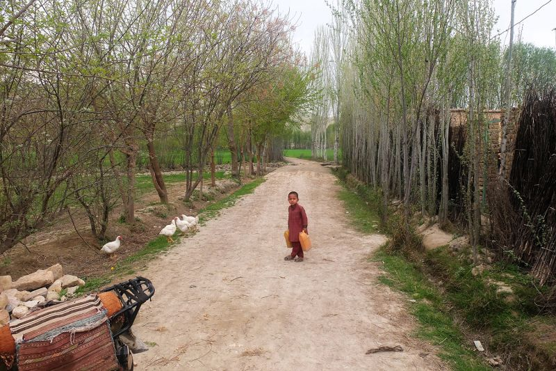 A child walks through a Taliban-controlled area in Baghlan province, Afghanistan, in April.