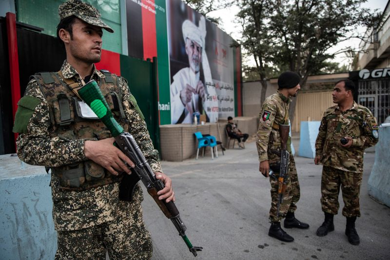Security guards patrol outside the election headquarters of Afghan President Ashraf Ghani in Kabul on Sept. 24 as they prepare for the upcoming presidential election.
