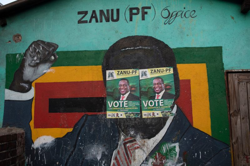 Election posters cover a mural of former President Robert Mugabe in Harare, Zimbabwe, on July 30, 2018.