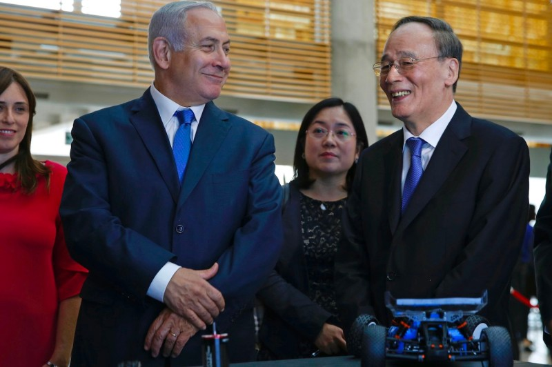 Chinese Vice President Wang Qishan and Israeli Prime Minister Benjamin Netanyahu attend the Israeli Innovation Summit in Jerusalem on Oct. 24, 2018.
