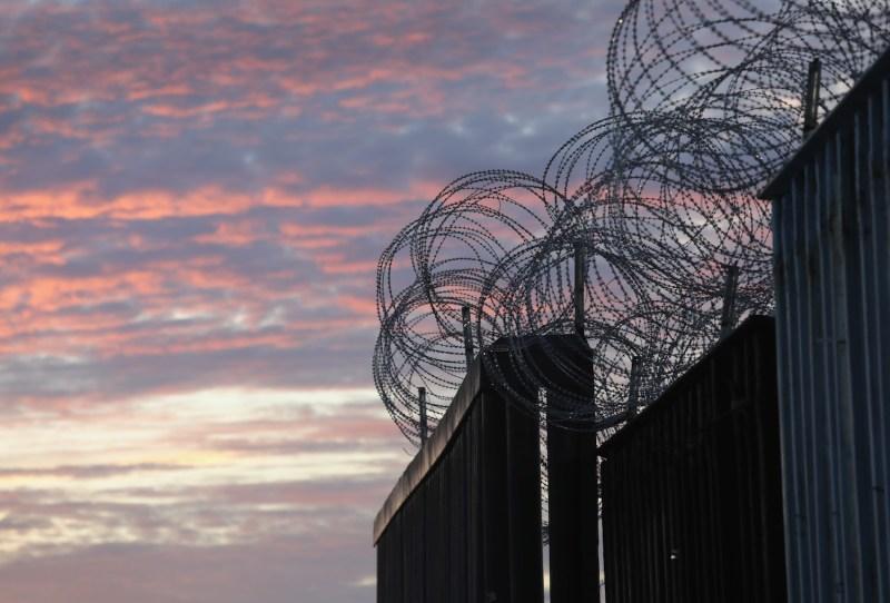 Razor wire tops the U.S.-Mexico border fence near Tijuana, Mexico, on Nov. 16, 2018.