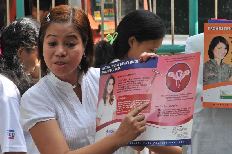 A Filipina health worker speaks to pregnant women on family planning in Navotas City, suburban Manila, on March 3, 2011.