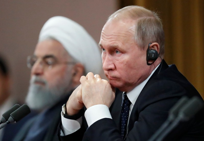 Russian President Vladimir Putin and Iranian President Hassan Rouhani attend a news conference in Sochi, Russia, on Feb. 14.