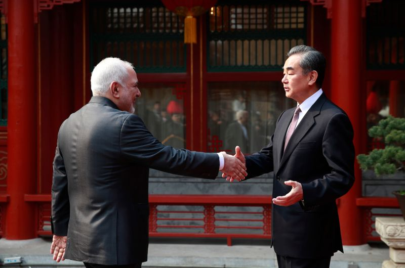 Iran's Foreign Minister Mohammad Javad Zarif and his Chinese counterpart, Wang Yi, shake hands during their meeting at the Diaoyutai State Guesthouse in Beijing on Feb. 19.