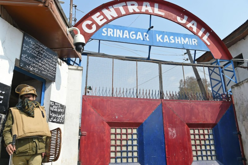 An Indian policeman comes out from a jail in downtown Srinagar, Jammu and Kashmir, on April 5.