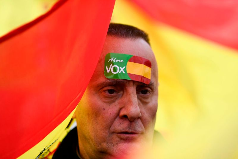"A protester with a sticker on his head reading ""Vox Now"" in reference to the Spanish far-right party Vox takes part in a demonstration in Madrid on Feb. 10."