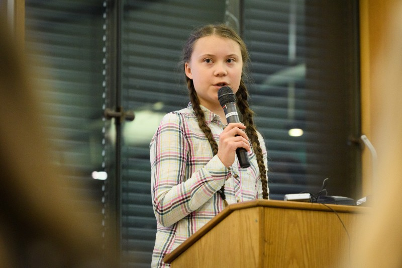 Swedish environmental campaigner Greta Thunberg addresses politicians, media and guests with the Houses of Parliament on April 23, 2019 in London, England.