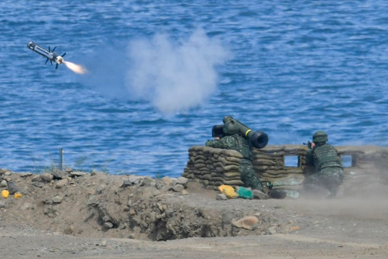 A soldier launches a Javelin missile during a military drill in southern Taiwan's Pingtung county on May 30, 2019.