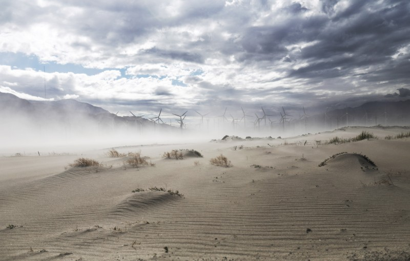 Strong winds blow sand at a wind farm in the Coachella Valley on May 6, 2019 in Palm Springs, California.