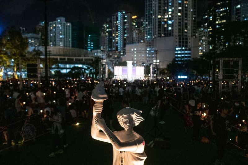 "A ""Goddess of Democracy"" statue looks out over a candlelight vigil in Hong Kong on June 4, marking the 30th anniversary of China's Tiananmen crackdown."