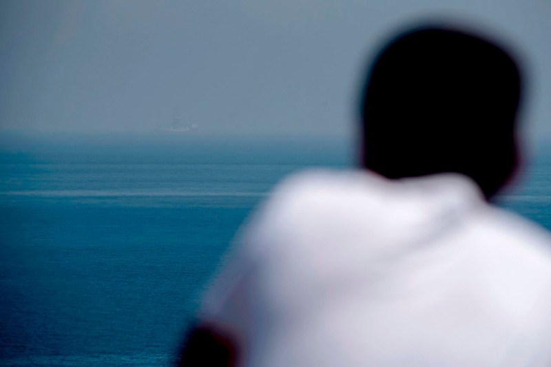 A man looks out to sea from the coastline of the self-proclaimed Turkish Republic of Northern Cyprus on July 21.