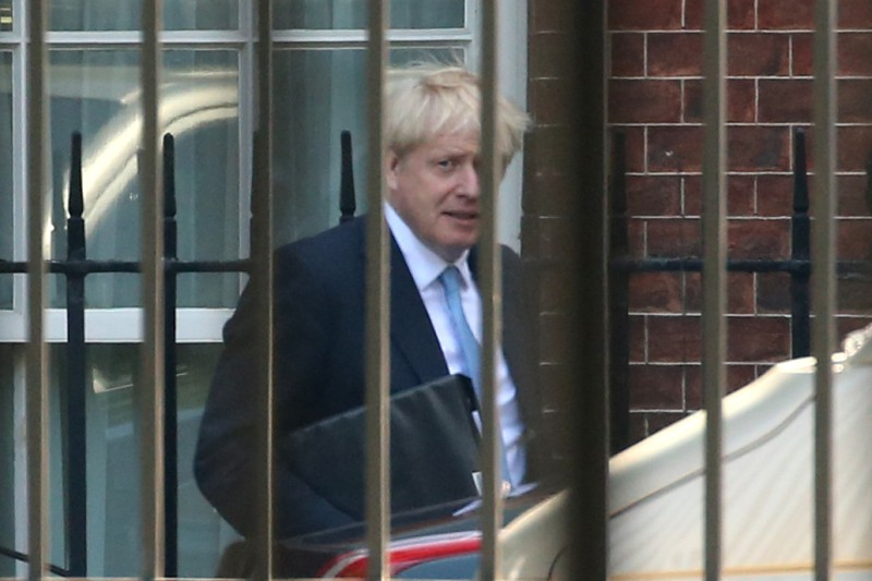 U.K. Prime Minister Boris Johnson leaves No. 10 Downing St. to address the Houses of Parliament in London on July 25.
