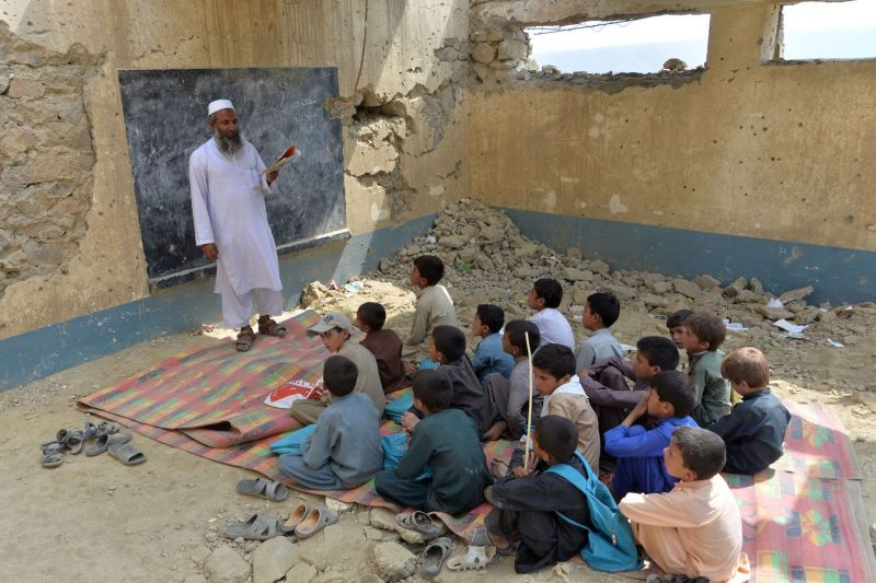 Afghan schoolchildren study amid the rubble of Papen High School in Nangarhar province on July 25.
