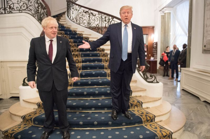 U.S. President Donald Trump and British Prime Minister Boris Johnson arrive for a bilateral meeting during the G-7 summit in Biarritz, France, on Aug. 25.