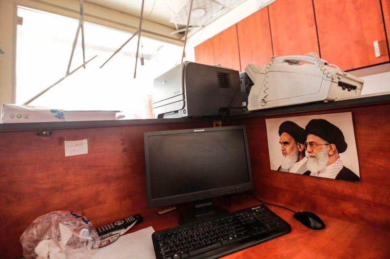 A media center of the Lebanese Shiite group Hezbollah is damaged in the south of the capital, Beirut, on Aug. 25.