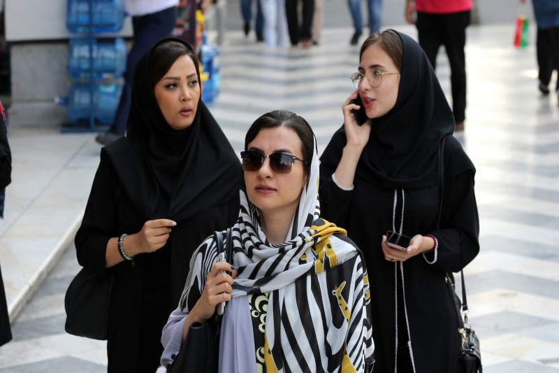 Iranian women walk in the capital, Tehran, on Aug. 27. Iran's economy has struggled with U.S. sanctions and could face even more after last weekend's attack on Saudi oil facilities.