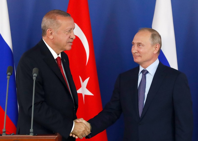 Turkish President Recep Tayyip Erdogan shakes hands with Russian President Vladimir Putin during a joint news conference following their talks on the sidelines of the MAKS 2019 International Aviation and Space Salon in Zhukovsky, outside Moscow on Aug. 27.