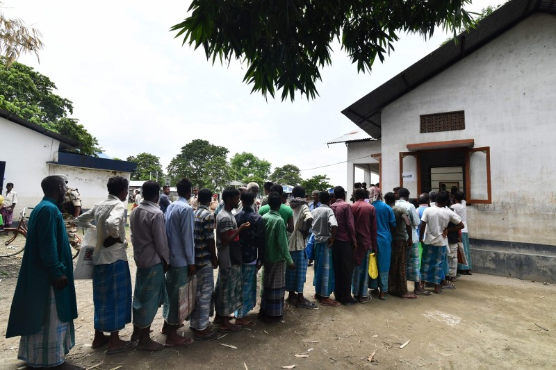 People stand in line to check their names on the final list of India's National Register of Citizens in a village some 40 miles from Guwahati, the largest city of the northeastern state of Assam, on Aug. 31.