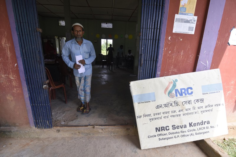 A man checks his name in the National Register of Citizens (NRC) in the Hojai District of Assam, India, on August 31.