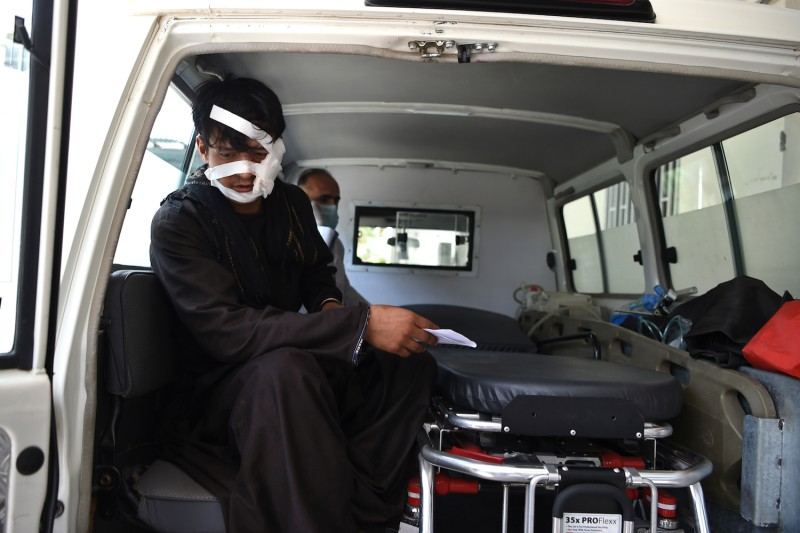 A wounded man is brought by ambulance to the Wazir Akbar Khan hospital following a suicide attack in Kabul on September 5, 2019.
