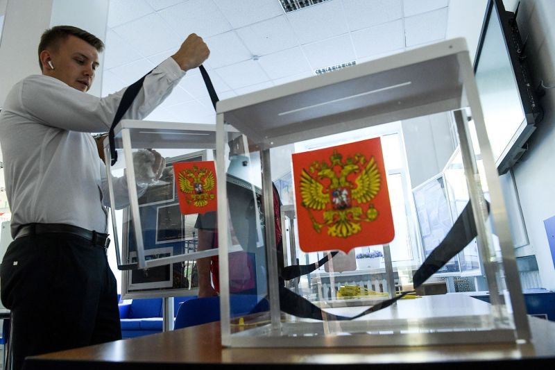 A member of a local election commission prepares a polling station ahead of elections in Moscow on Sept. 6.