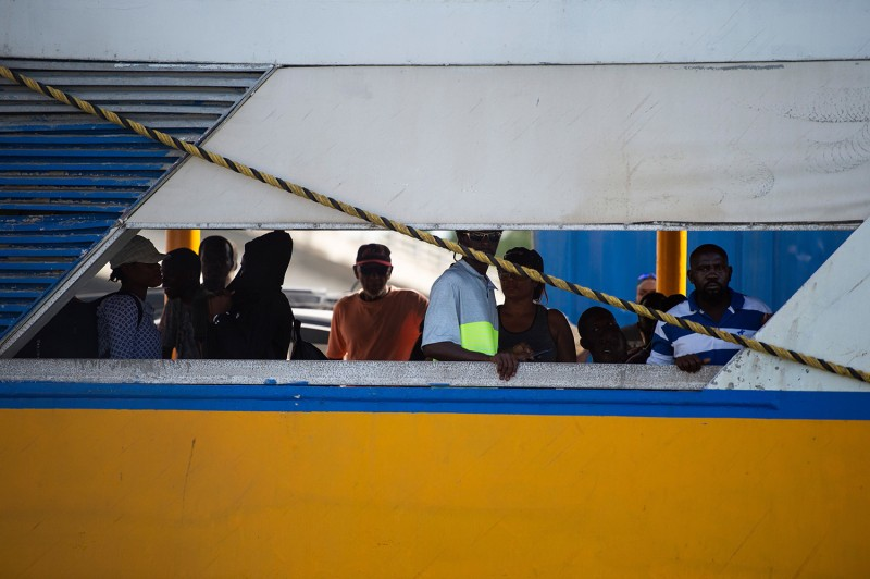 Evacuees look on from a ferry after leaving Marsh Harbour in the aftermath of hurricane Dorian in Nassau, Bahamas, on September 9.