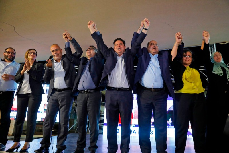 Joint List candidates join hands in the northern Israeli city of Nazareth on Sept. 17, as exit poll results are announced.