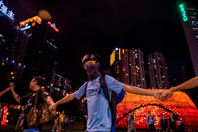 Pro-democracy protesters participate in a human chain event in Victoria Park in Hong Kong on Sept. 18.