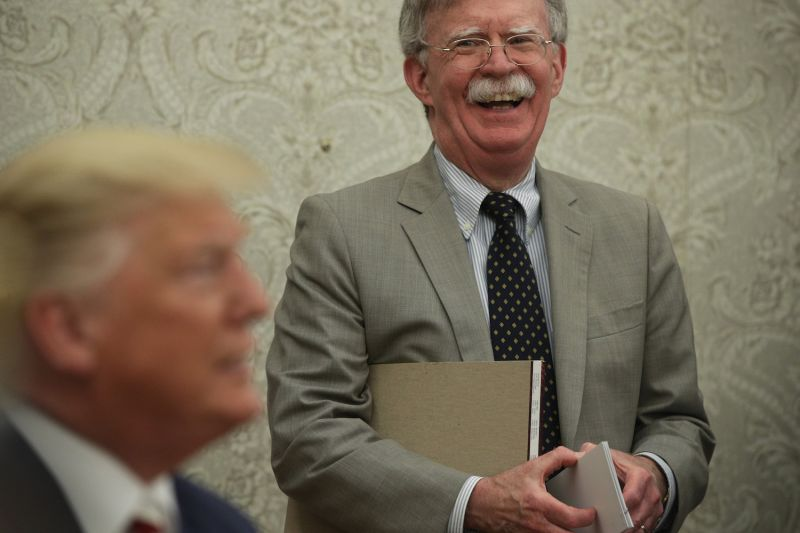 Now-departed U.S. National Security Advisor John Bolton in the Oval Office with President Donald Trump at the White House on Aug. 20,