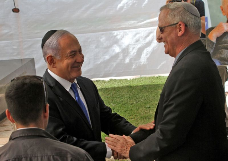 Israeli Prime Minister Benjamin Netanyahu (left) greets Benny Gantz, the leader of Blue and White party, at a memorial ceremony for late Israeli President Shimon Peres in Jerusalem on Sept. 19.