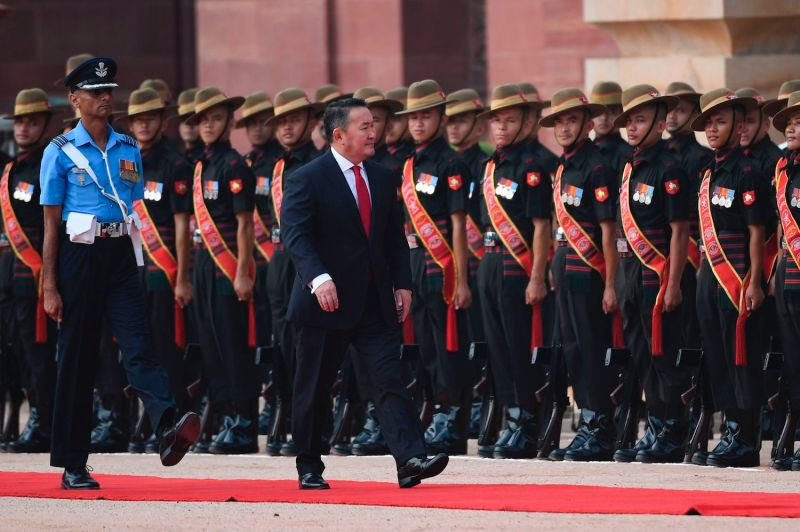 Mongolian President Khaltmaagiin Battulga reviews an honor guard during a ceremonial reception in New Delhi on Sept. 20.