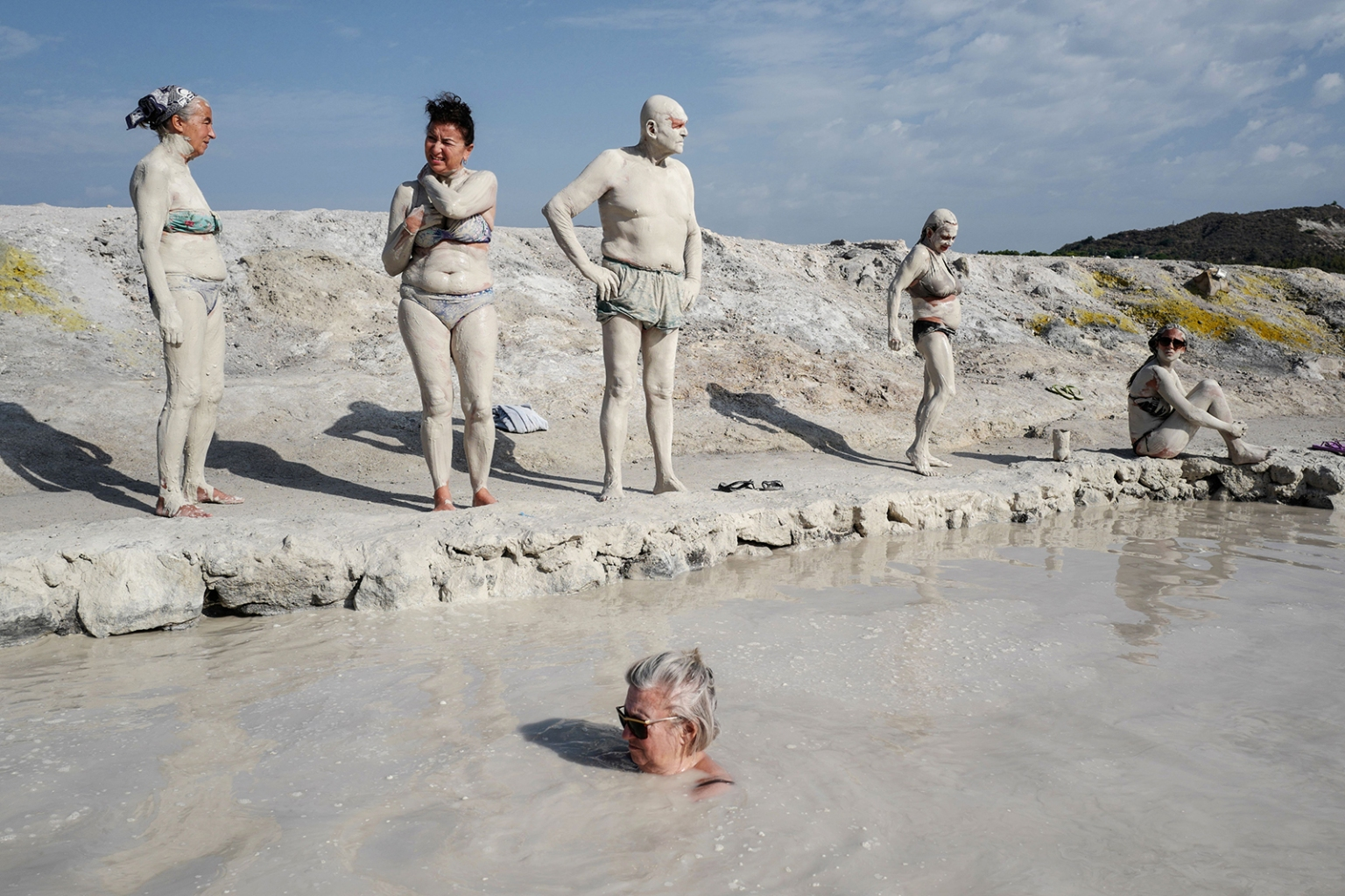 People bath in sulphurous mud on the volcanic island of Vulcano, one of the Aeolian Islands, in the Tyrrhenian Sea, Italy, on Sept. 19. VALERY HACHE/AFP/Getty Images
