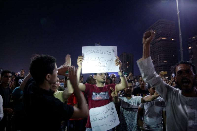 Egyptian protesters shout slogans as they take part in a protest calling for the removal of President Abdel Fattah al-Sisi in Cairo's downtown on September 20, 2019.