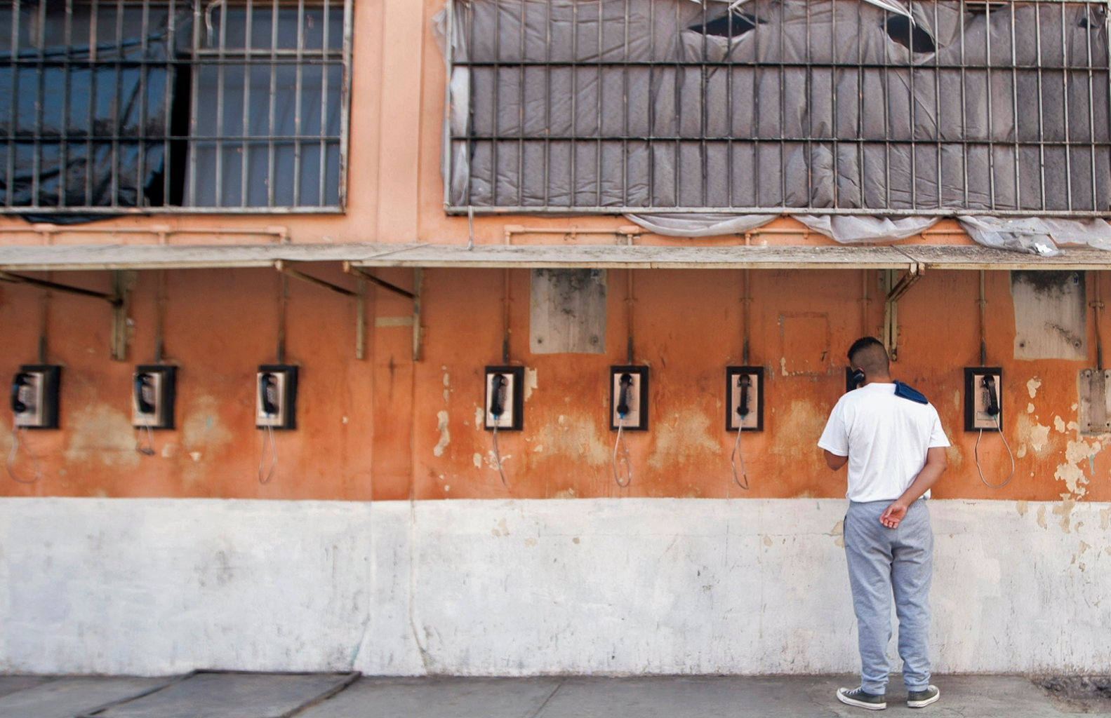 An inmate speaks on the phone on visiting day at the Topo Chico prison in Monterrey, Mexico, on Sept. 21. The prison will close on Sept. 30, and its 2,685 inmates will be transferred to other prisons in the city. JULIO CESAR AGUILAR/AFP/Getty Images