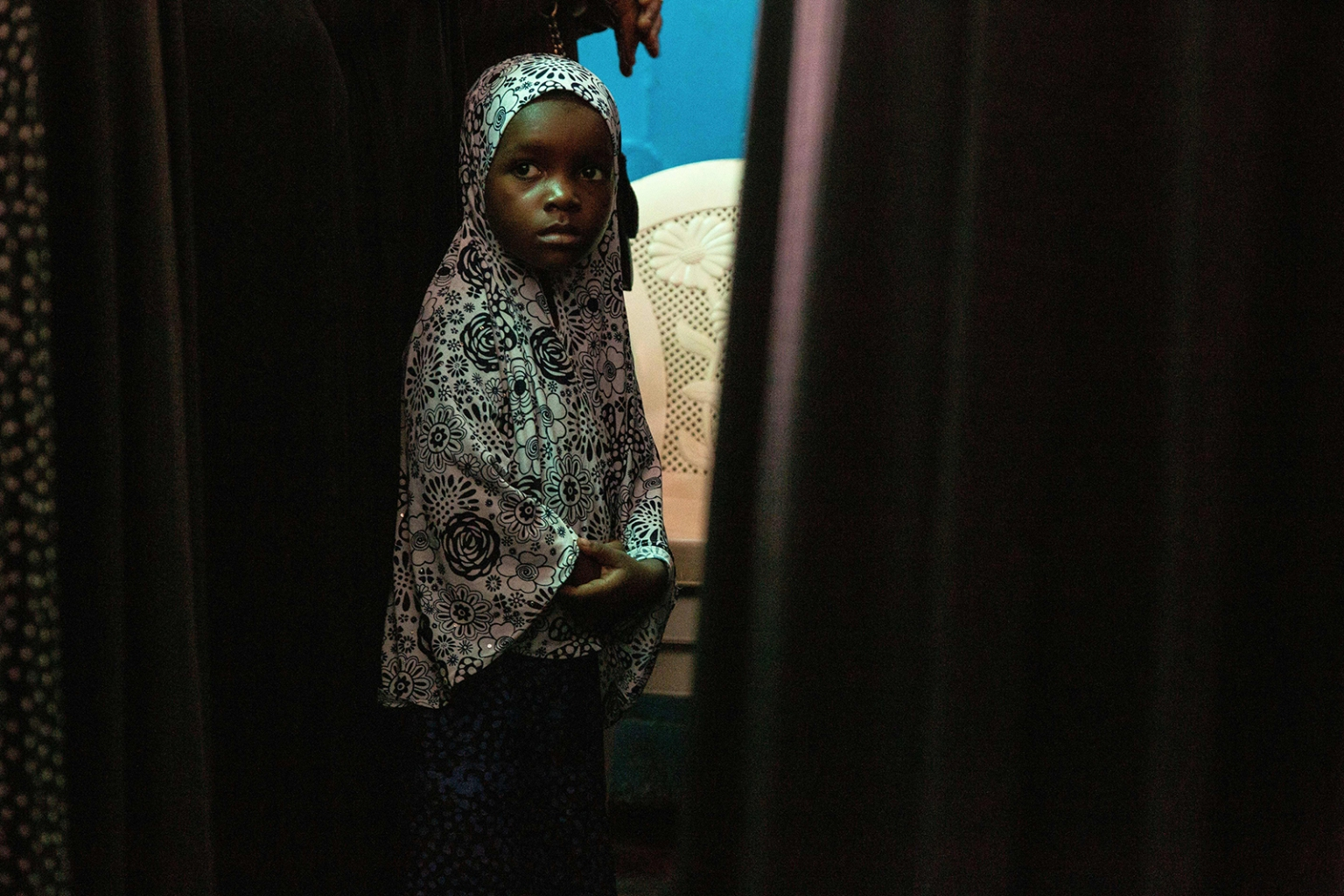 A girl attends a memorial service in Monrovia for victims of a recent fire at a Koranic school in the Liberian capital on Sept. 22. Only eight of the 36 people inside the building survived when the fire broke out in the early morning as the victims slept in the school dormitory. CARIELLE DOE/AFP/Getty Images
