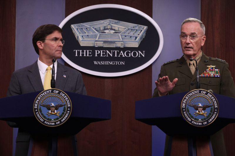 U.S. Secretary of Defense Mark Esper and Chairman of Joint Chiefs of Staff Joseph Dunford hold a media briefing at the Pentagon in Arlington, Virginia, on Aug. 28.