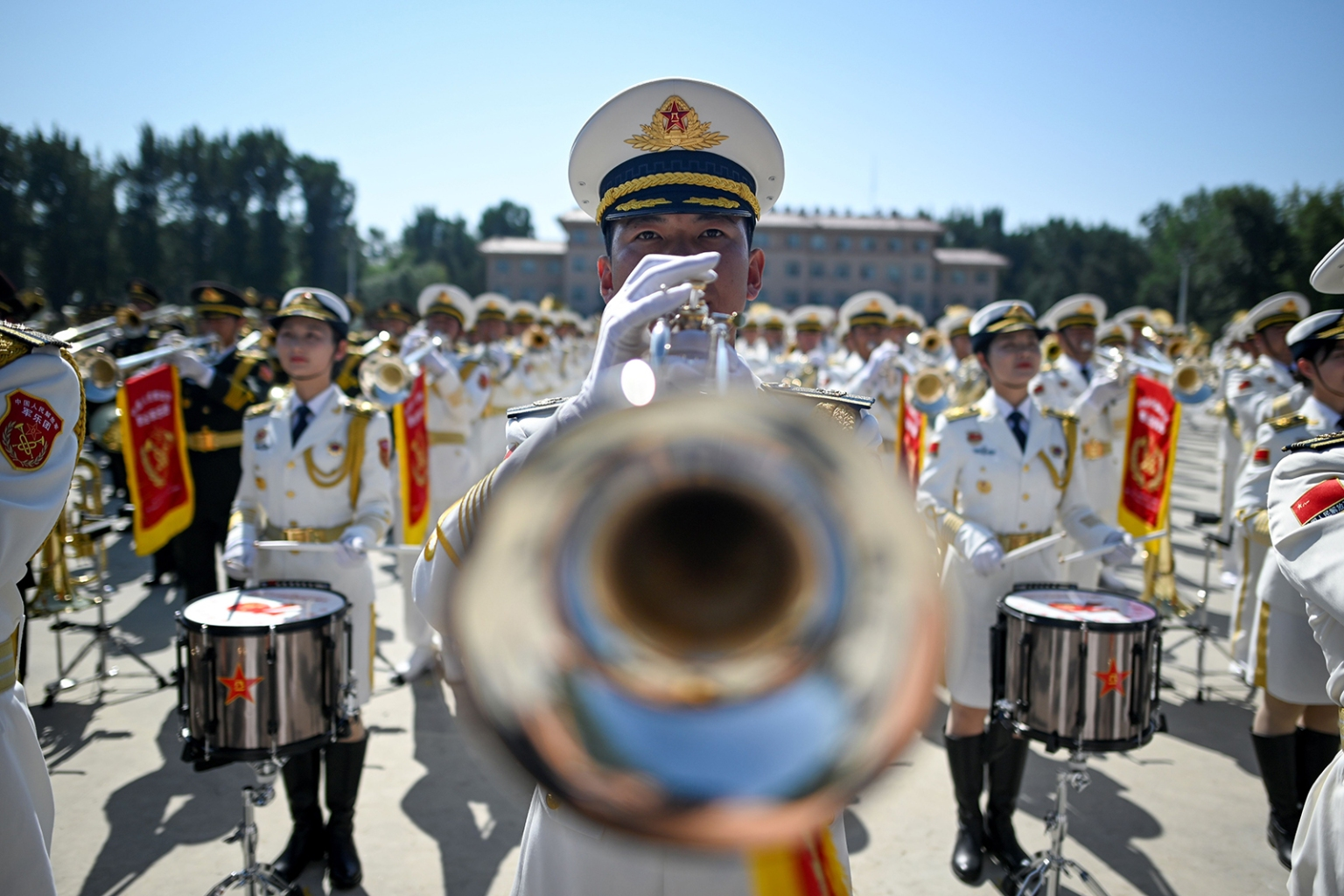 A member of a Chinese military band performs during a tour arranged for the media in celebration of the 70th anniversary of the country's founding at a camp on the outskirts of Beijing on Sept. 25. WANG ZHAO/AFP/Getty Images