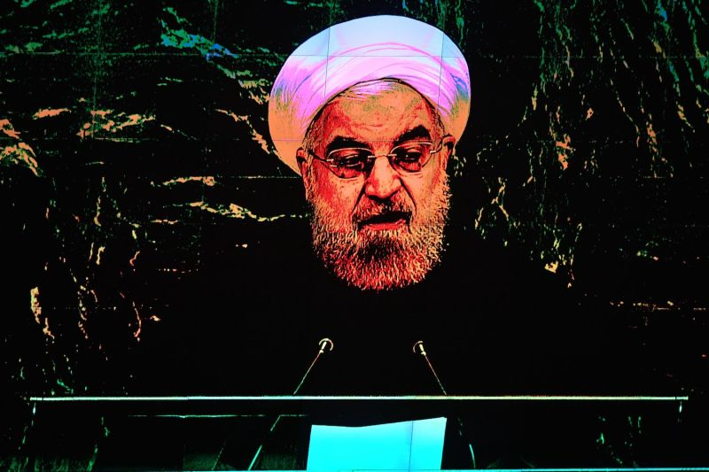Displayed on a monitor, Iranian President Hassan Rouhani addresses the United Nations General Assembly in New York on Sept. 24.