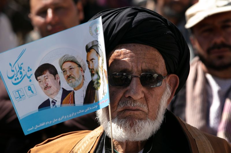 An Afghan man attends a campaign rally for Abdullah Abdullah, the chief executive of Afghanistan, in Bamiyan on Sept. 25 (Photo by Paula Bronstein/Getty Images )