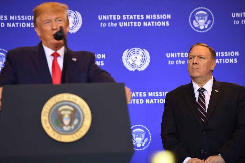 U.S. Secretary of State Mike Pompeo listens as President Donald Trump holds a press conference on the sidelines of the U.N. General Assembly in New York on Sept. 25.