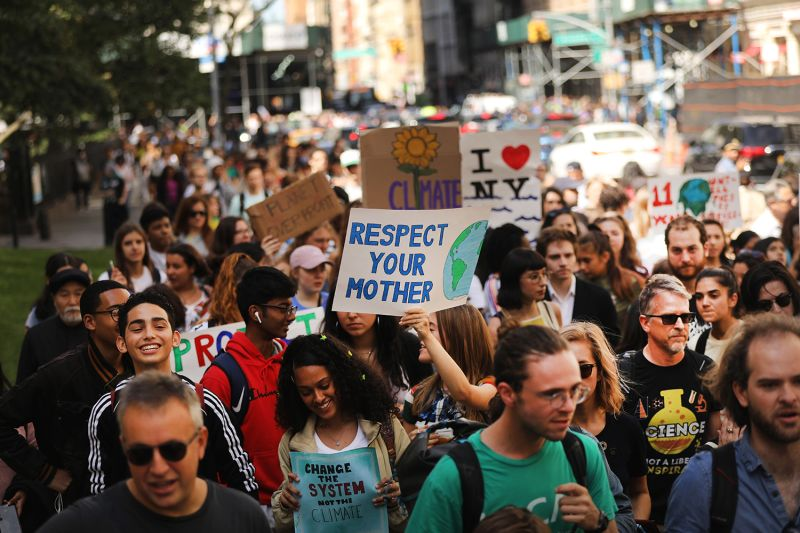 People march as they take part in a strike to demand action on the global climate crisis on Sept. 20 in New York City.