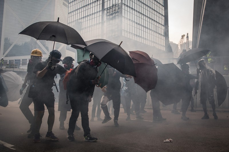 Pro-democracy protesters clash with police during a march on Sept. 29 in Hong Kong.