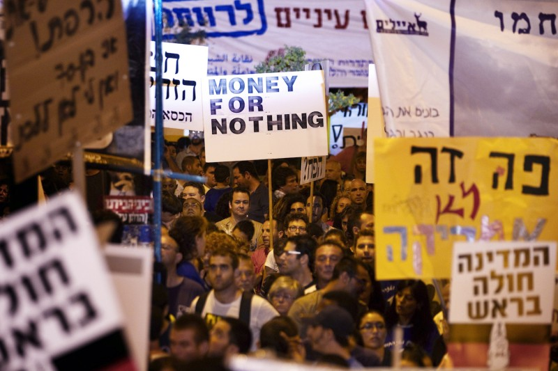 Thousands of demonstrators in the southern Israeli city of Beersheba protest against rising housing prices and social inequality on Aug. 13, 2011.
