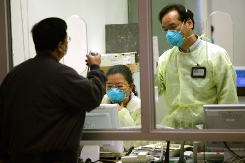 Staff at the Prince of Wales hospital in Hong Kong wear face masks to protect themselves from SARS on March 14, 2003.