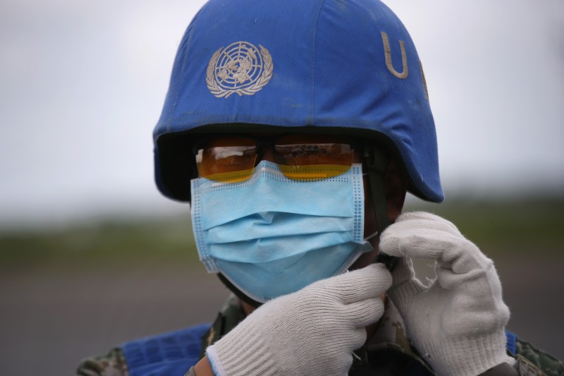 A Chinese U.N. soldier prepares a truckload of Ebola relief aid after it was airlifted by the United Nations Children's Fund (UNICEF), on August 23, 2014 in Harbel, Liberia.