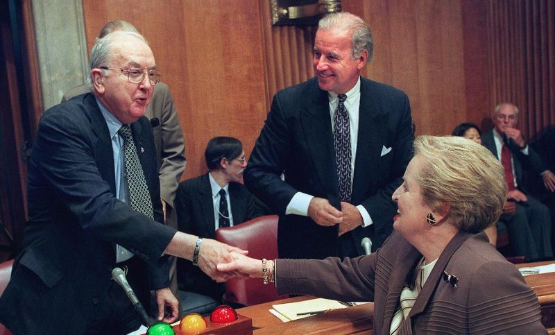 Sens. Joe Biden (right) and Jesse Helms, the chairman of the Senate Foreign Relations Committee, chat with Secretary of State Madeleine Albright on Capitol Hill in Washington on Oct. 7, 1999.
