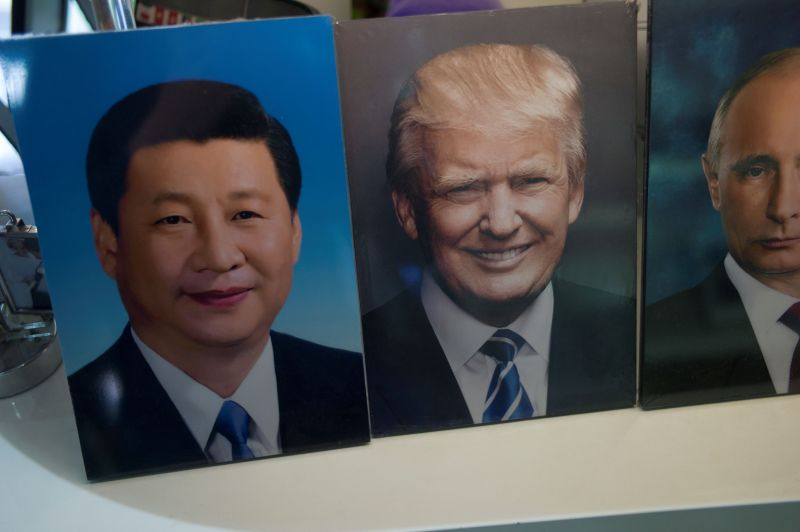 Frames of Chinese President Xi Jinping, US President Donald Trump and Russian President Vladimir Putin are display in a photo shop in Beijing on April 17, 2017.
