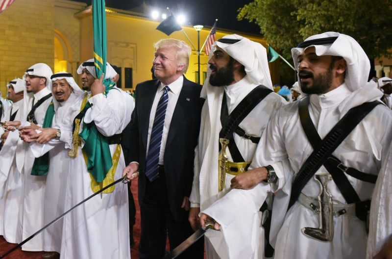 President Donald Trump joins dancers with swords at a welcome ceremony ahead of a banquet at the Murabba Palace in Riyadh on May 20, 2017. /